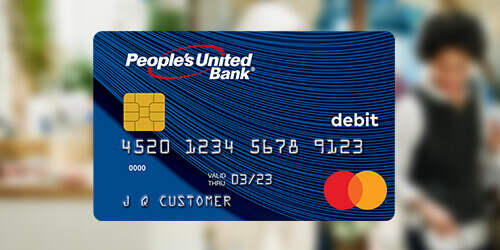 People's United Bank blue Mastercard® Debit Card on a blurred background of friends shopping