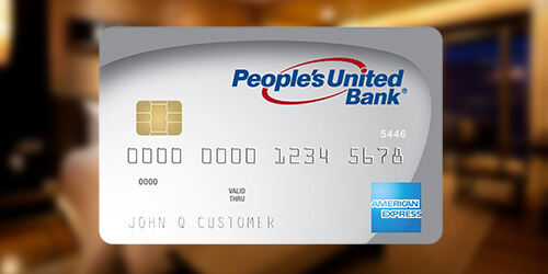 People's United Bank American Express Premier personal credit card on top of a blurred background image of a hotel room
